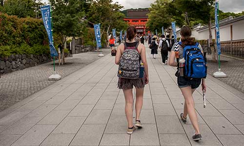 student travelers walking