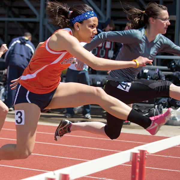 Female student-athlete participating in a hurdles race