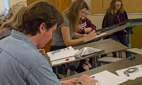 students in a drawing class