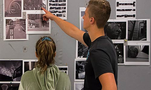 two students during a photography critique session