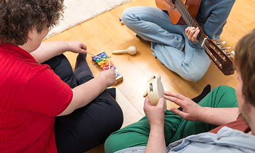 a music therapy session with three people