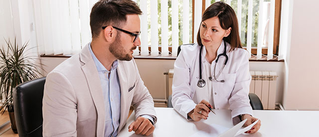 healthcare administrator speaking with a doctor