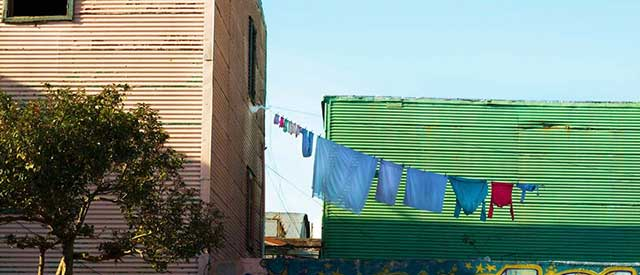 laundry hanging from a line in urban setting