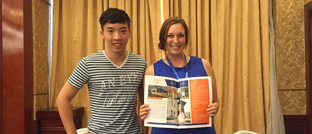 Duy Nguyen standing with Megan Couch, Carroll University International Student Coordinator