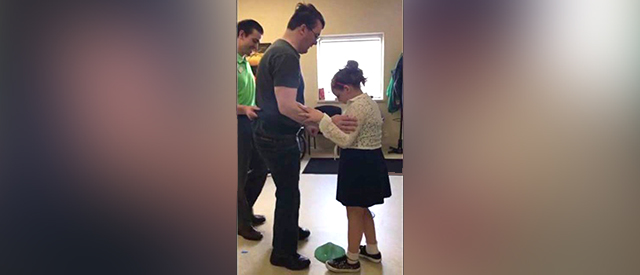 Brian Baker Dancing with His Daughter at Carroll's Therapeutic Abilities Clinic