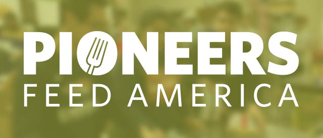 Voluteers at a food bank with the Pioneers Feed America logo