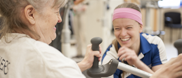 Physical therapy student works with a client