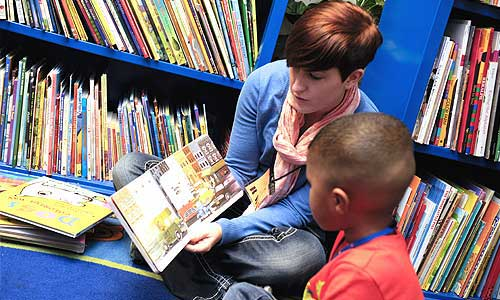 Alumni reading to child