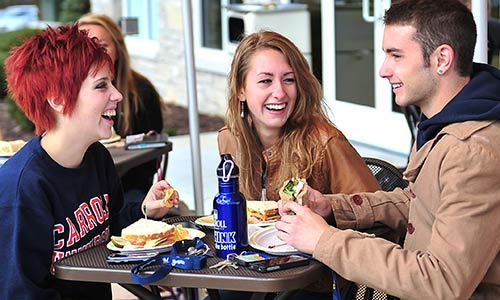 Photo of three friends eating at Au Bon Pain