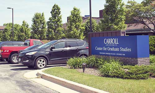 cars in the Carroll University Center for Graduate Studies parking lot