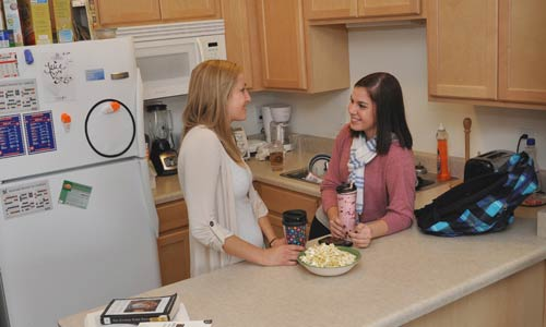 Photo of two girls in kitchen