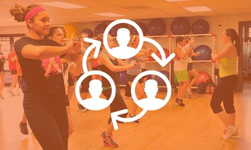 a Zumba class in the Carroll YMCA with a circular icon of people on top