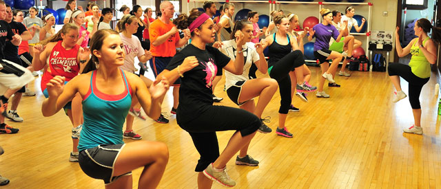 large group of students in a Zumba class