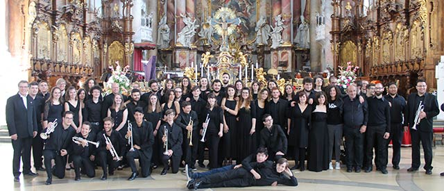students performing in cathedral