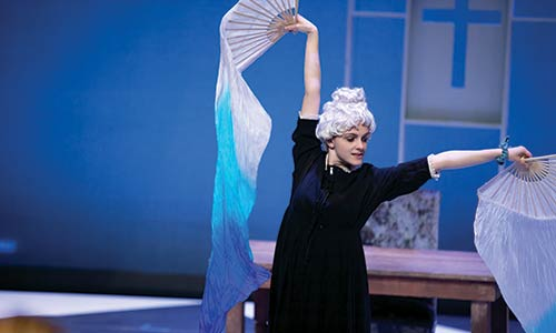 "student actress performing in a dress rehearsal of ""Tartuffe"""