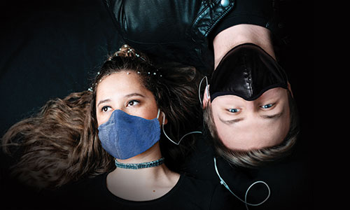 actor and actress with masks