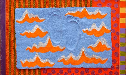 colorful artwork with orange waves and footprints on a blue background