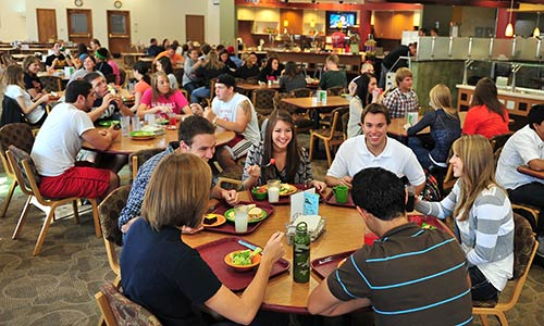 large groups of male and female students having lunch in the Campus Center's Main Dining Hall