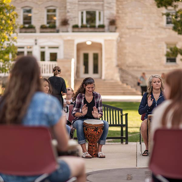 students playing instruments on main lawn