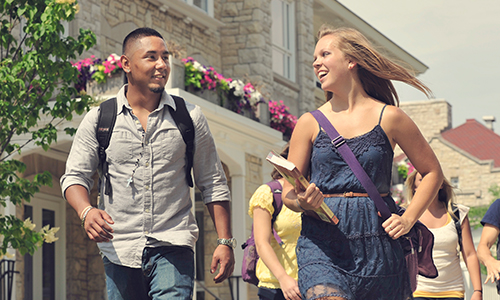 students walking around campus on a sunny day